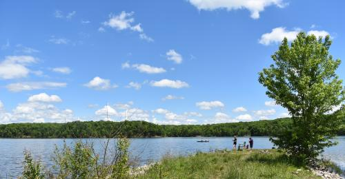 Couple fishing on the shore of Deam Lake State Recreation Area