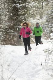 Couple Snow Shoeing In Minocqua, WI
