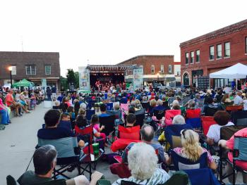 Enjoy live music by Living Proof at Summer Sounds on the Square on Saturday night.
