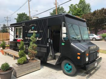 Preston's Burgers food truck - black truck with teal & white accents, logo, order window and menu