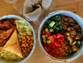 View of food bowls from Hoyo's Kitchen Somali restaurant in North Market