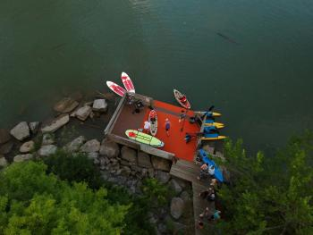 Visitors prepare to head out and explore in kayaks on a warm summer day