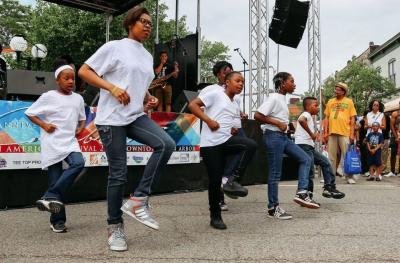 Children perform a dance routine at the African American Summer Festival in Ann Arbor