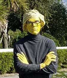 Yellow Andy sculpture - close up - at Peace River Botanical & Sculpture Gardens