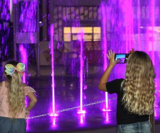 Girls watching Fountain Show at ONE DAYTONA