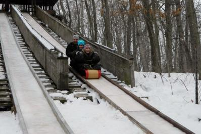 Adults Tobogganing from Marcie Post
