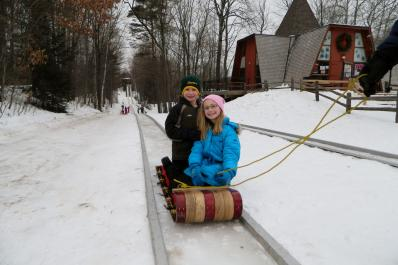 Brother and Sis on Toboggan from Marcie Post