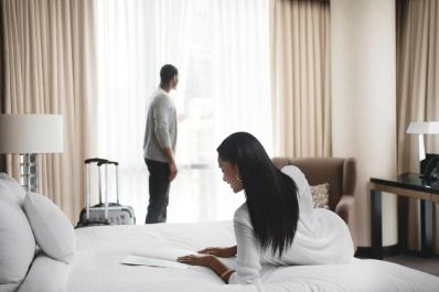 couple looking at in room dining menu