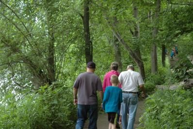 Family hiking along the River Trail
