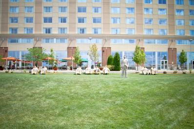 Groomsmen Relaxing in front of Hotel