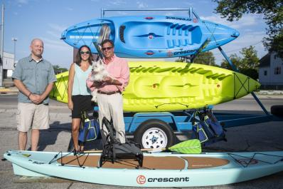 Owners with kayaks