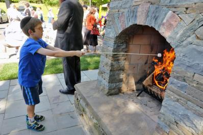 Boy roasting marshmallow at Jewish Discovery Center