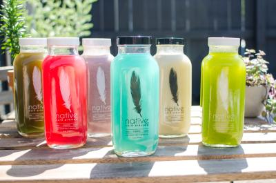 Vibrantly colored bottles of organic juice from Native Cold Pressed
