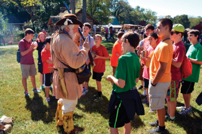 A historical reenactor teaches history to a group of kids in Knoxville, TN