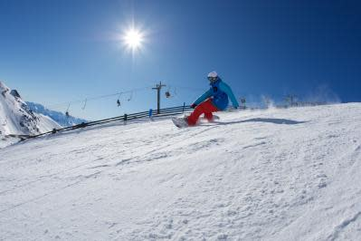A snowboarder rips it up at The Remarkables ski area