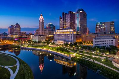 Lit-up Columbus Skyline at night on Scioto riverfront downtown