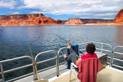 Person fishing on boat at Lake Powell