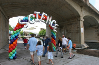 A family walks through a balloon arch that says SCIENCE in Knoxville, TN