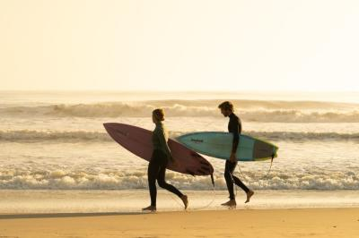 Couple with Suf Boards in Outer Banks
