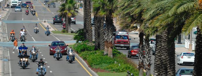 Bikers Ride Along A1A Under Blue Skies and Palm Trees