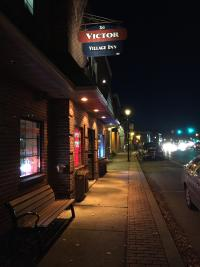 Exterior shot of Victor Village Inn at night