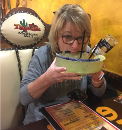 A woman drink a large Bull Dog Margarita at Tequila's Mexican Grill in Garden City, KS
