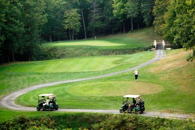 Golfers walk through the course towards the green at Bristol Harbour's Golf Course