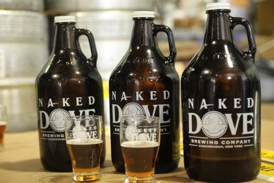 Bottles of Cider sit out on a table at Naked Dove Brewery
