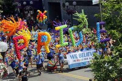 """Rainbow balloons spelling out word """"PRIDE"""" in parade during Columbus Pride Festival"""
