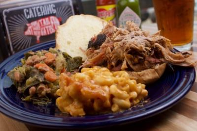 Plated BBQ sandwich with collard greens and mac and cheese from Sweet P's BBQ