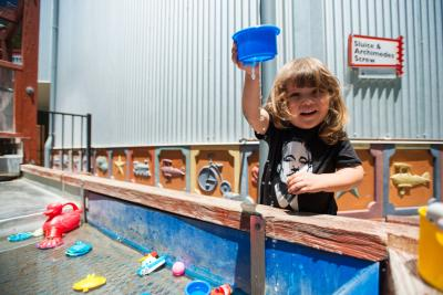 Smal child playing with water in the SLO Children's Museum