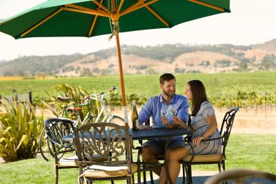 Couple enjoying a bottle of wine at a winery in SLO CAL