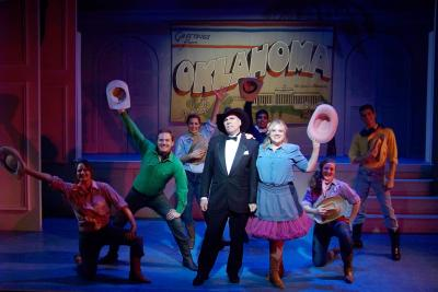 The cast for a musical poses on stage at the Bristol Valley Theatre