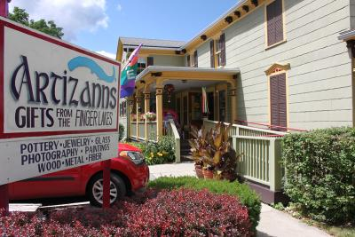 Exterior of the Artizanns building with their outdoor sign