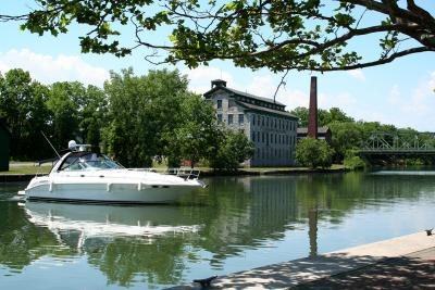 A boat travels through Seneca Falls while on the Erie Canal