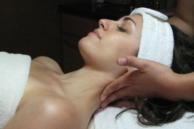 A woman enjoys a relaxing massage while in the Finger Lakes