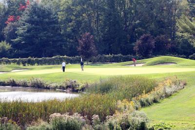 A group of golfers play a round at Bristol Harbour's Golf course
