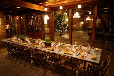 A table sits prepared for dinnertime at Ravines winery