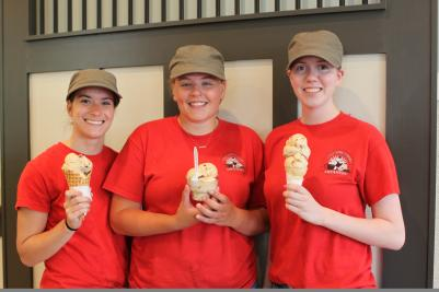 Three employees pose with icecream cones at the Cheshire Farms Creamery