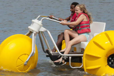 Kids riding on a water water trike