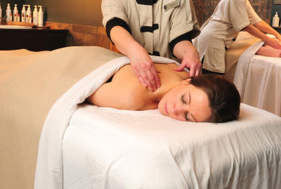 A woman enjoys a relaxing massage at Isabella Spa in Belhurst Castle