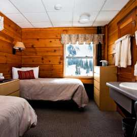 A room in the original wing of Alta Lodge with two twin beds.