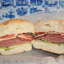 The Berlin; German Salami, Thuringer, and Butter Cheese on a White Rosette Bun, Sm. $6.10, Lg. $7.25