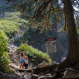 A sign warns hikers of the dangers of climbing up to the falls, photo by John Badila