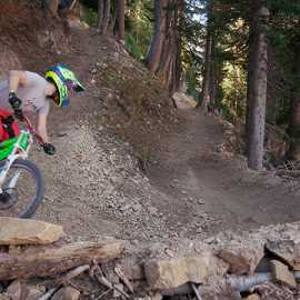 Railing a berm in the lower pines, photo by Brant Hansen