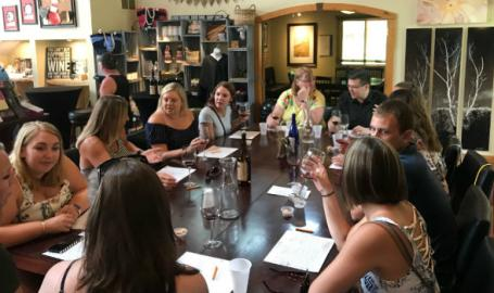 South Shore Brew Bus group around table at brewery