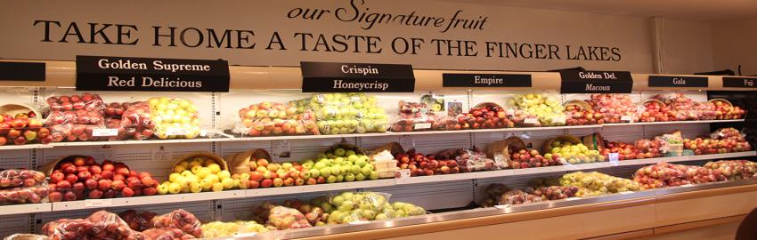 Fresh produce sits on refrigerated shelves inside of Red Jacket Orchard