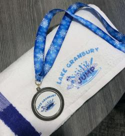 White towl and medal with Goosebump Jump logo
