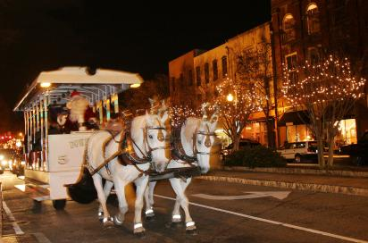 Horse-drawn trolley tour led by Santa