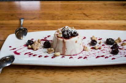 Panna Cotta with port cherries and walnuts drizzled with cherry sauce